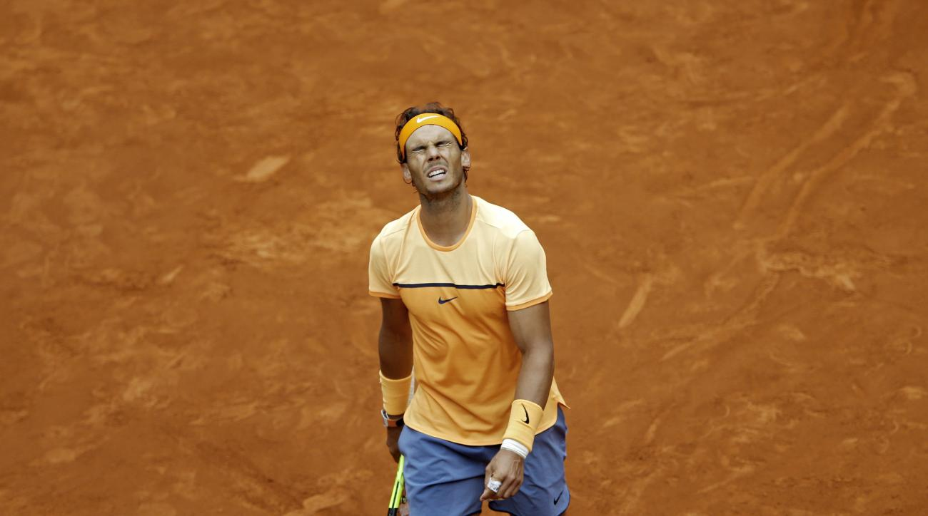 Rafael Nadal, from Spain, gestures after losing a point to Andy Murray, from Britain, during their semifinal match at the Madrid Open tennis tournament match in Madrid, Spain, Saturday, May 7, 2016. Murray won 7-5, 6-4 and will play the final on Sunday 8.