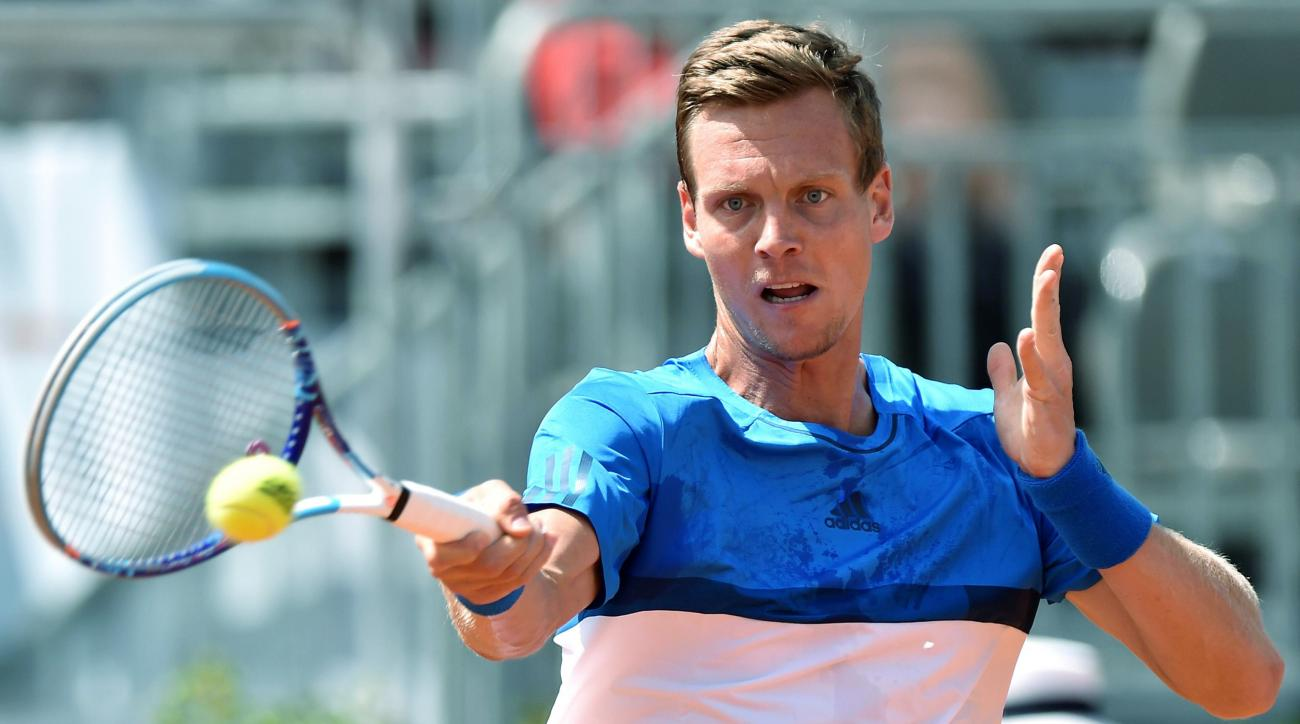 Tomas Berdych of the Czech Republic returns the ball to Albert Ramos-Vinolas of Spain during their match at the Italian Open tennis tournament, in Rome, Tuesday, May 10, 2016. (Ettore Ferrari/ANSA via AP Photo) ITALY OUT