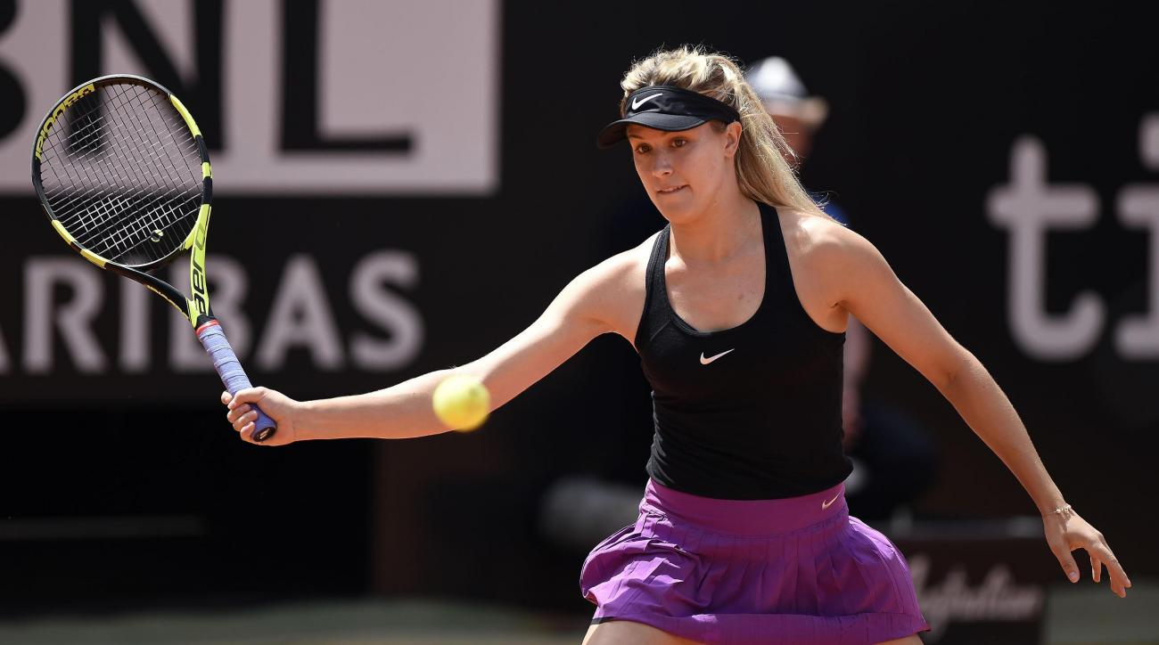 Eugenie Bouchard of Canada returns the ball to Jelena Jankovic of Serbia during their match at the Italian Open tennis tournament, in Rome, Tuesday, May 10, 2016. (Claudio Onorati/ANSA via AP Photo) ITALY OUT