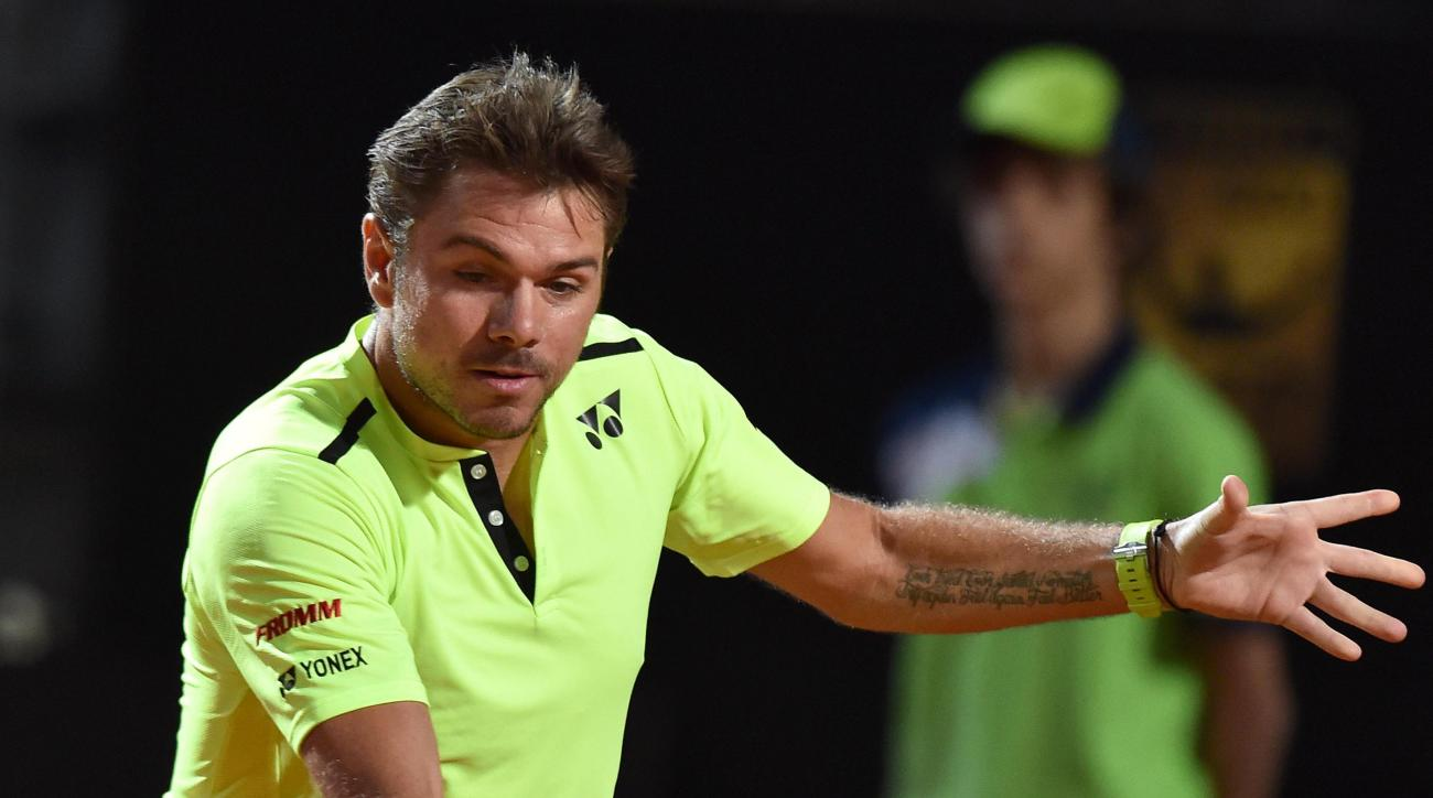 Stan Wawrinka of Switzerland returns the ball to Benoit Paire of France during their match at the Italian Open tennis tournament, in Rome, Tuesday, May 10, 2016. (Ettore Ferrari/ANSA via AP) ITALY OUT