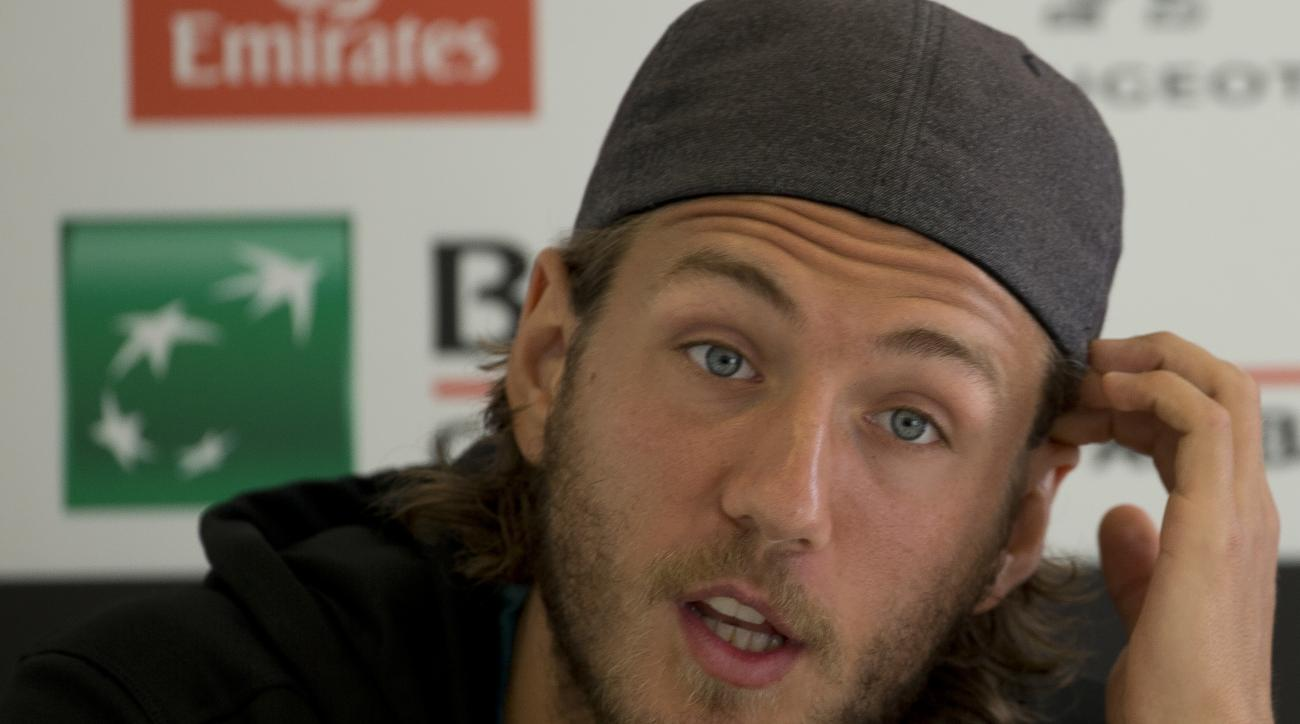 France's Lucas Pouille gives a press conference after Argentina's Juan Monaco withdrew, because of injury, from their quarter final match at the Italian Open tennis tournament, in Rome, Friday, May 13, 2016. (AP Photo/Alessandra Tarantino)