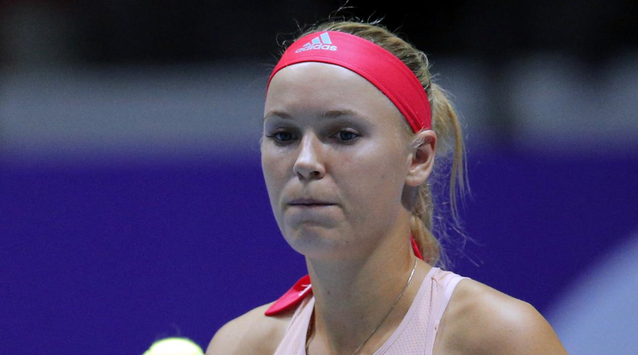 FILE- In this Feb. 11, 2016, file photo, Caroline Wozniacki, of Denmark, pauses during a match against Dominika Cibulkova, of Slovakia, at the St. Petersburg Ladies Trophy tennis tournament  in St. Petersburg, Russia. The WTA says, Tuesday, May 17, 2016,