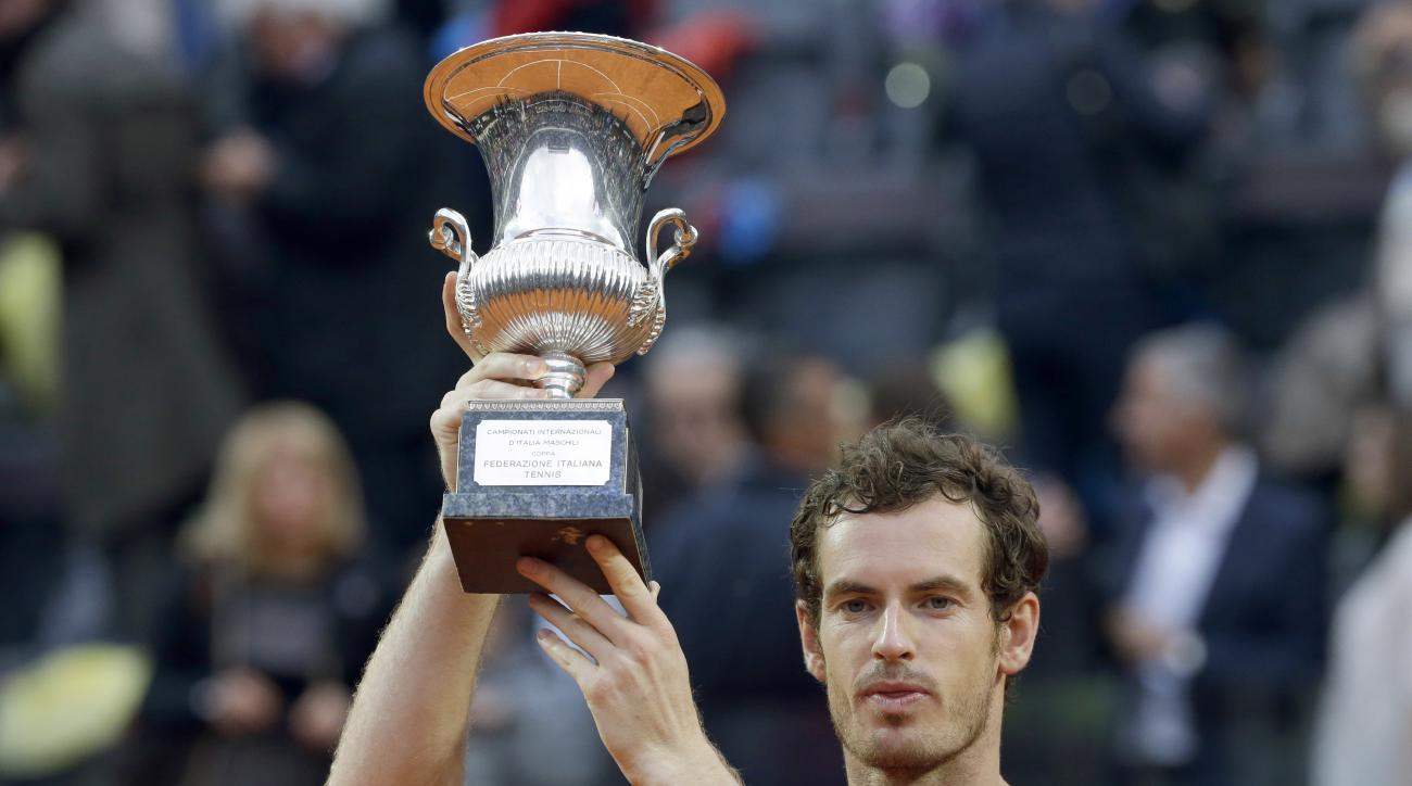 FILE - This May 15, 2016 file photo shows Andy Murray raising the trophy after defeating Novak Djokovic in the final match of the Italian Open tennis tournament in Rome. The French Open begins on Sunday, May 22. (AP Photo/Alessandra Tarantino, file)