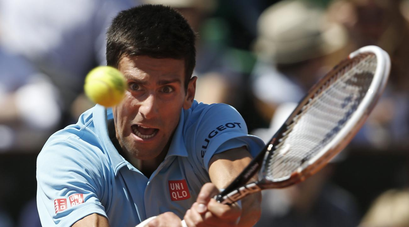 FILE - In this June 6, 2014, file photo, Serbia's Novak Djokovic returns the ball during the semifinal match of the French Open tennis tournament against Latvia's Ernests Gulbis in Paris, France. The French Open begins on Sunday, May 22, 2016. (AP Photo/D