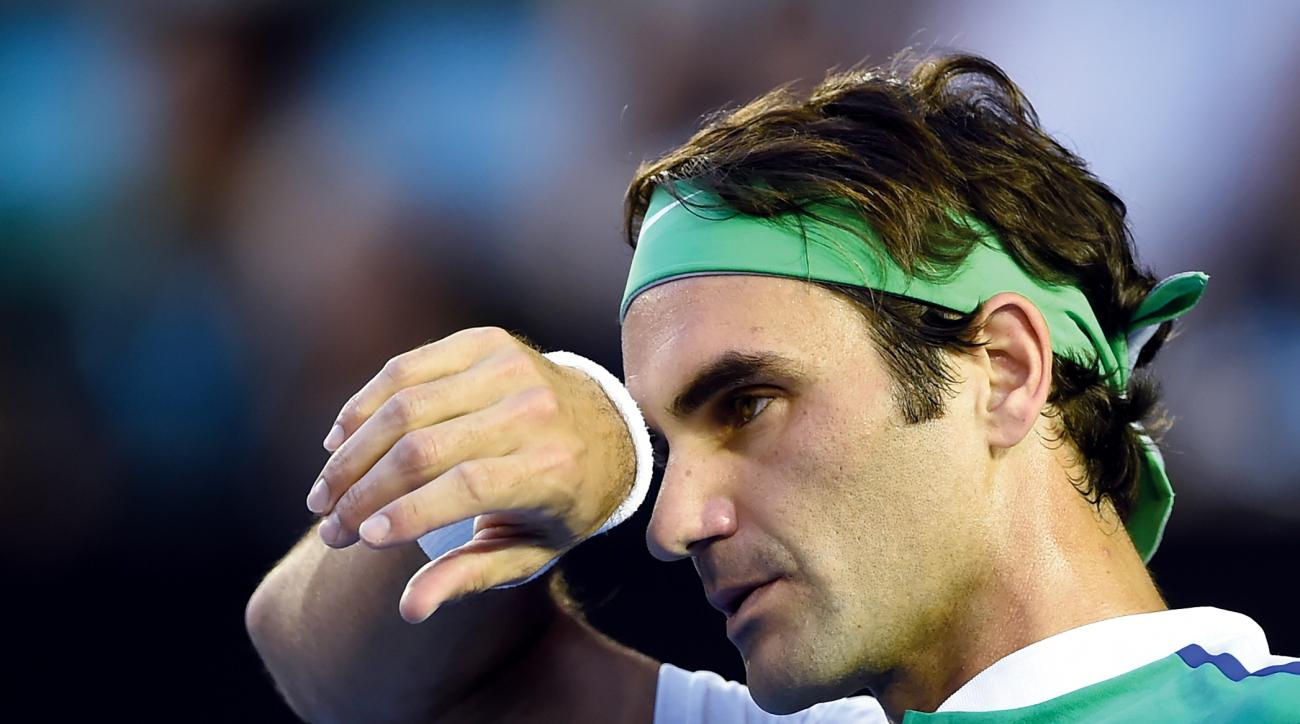 FILE- In this Thursday, Jan. 28, 2016 file photo, Roger Federer of Switzerland wipes the sweat from his face during his semifinal match against Novak Djokovic of Serbia at the Australian Open tennis championships in Melbourne, Australia. Swiss star Roger