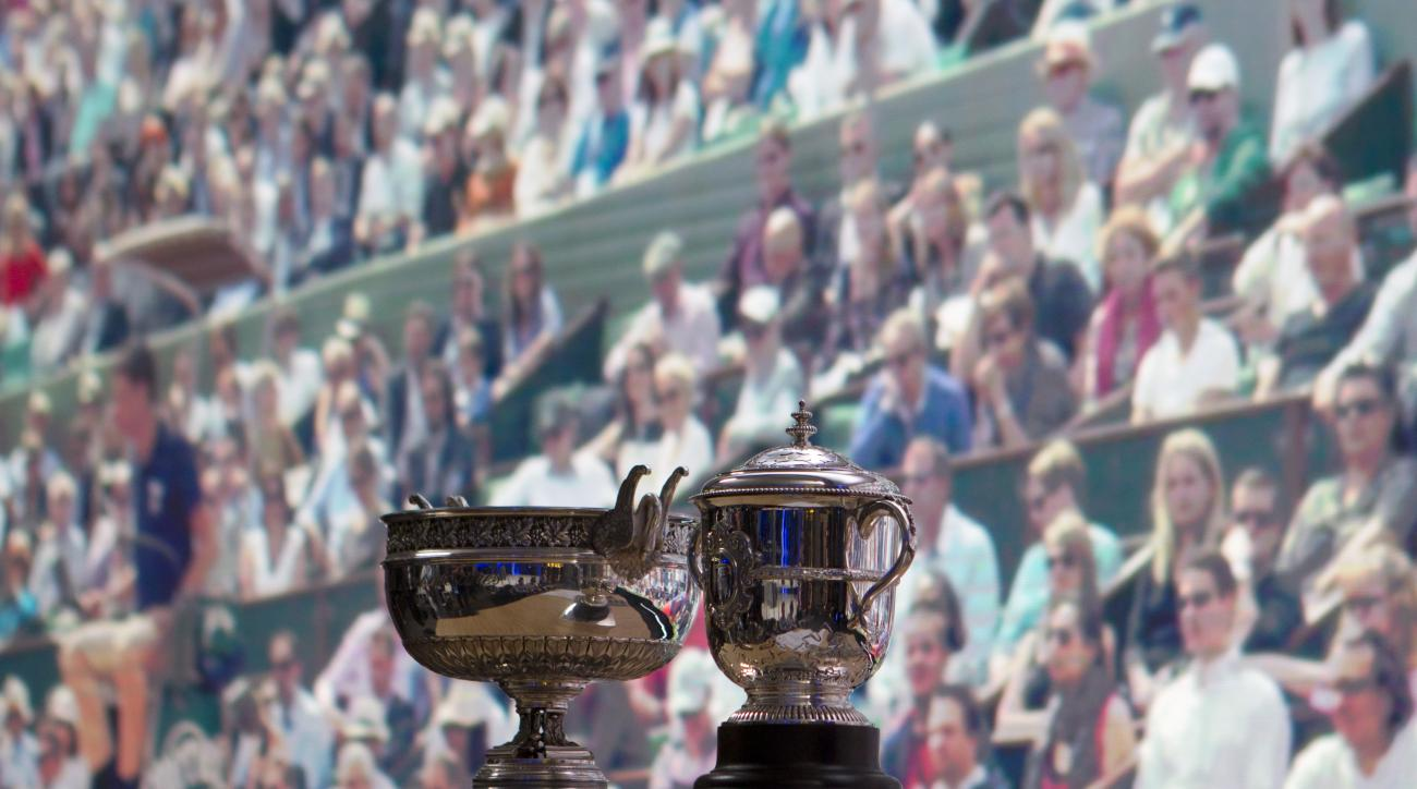 The men's cup, left, and women's cup are seen before the draw of the French Open tennis tournament at the Roland Garros stadium, Friday, May 20, 2016 in Paris. The French Open starts Sunday May 22. (AP Photo/Bertrand Combaldieu)