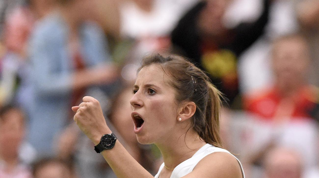 Annika Beck of Germany celebrates after winning her match against Timea Bacsinszky of Switzerland during their Fed Cup World Group first round tennis match between Germany and Switzerland at the Leipzig Fair in Leipzig, Germany, Sunday, Feb. 7, 2016. (AP