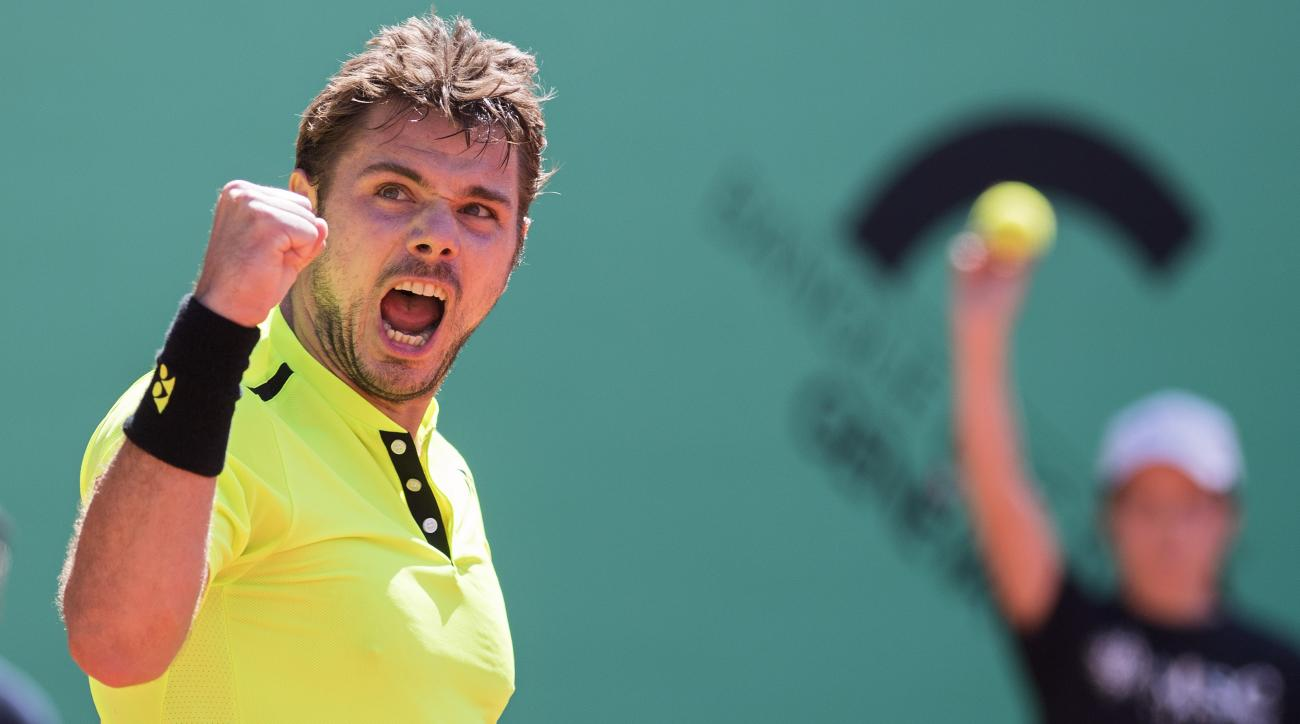 "Switzerland's tennis player Stanislas ""Stan"" Wawrinka, celebrates a point against  Marin Cilic, of Croatia, during the final match of the Geneva Open ATP 250 Tennis tournament, in Geneva, Switzerland, Saturday, May 21, 2016. (Martial Trezzini/Keystone via"