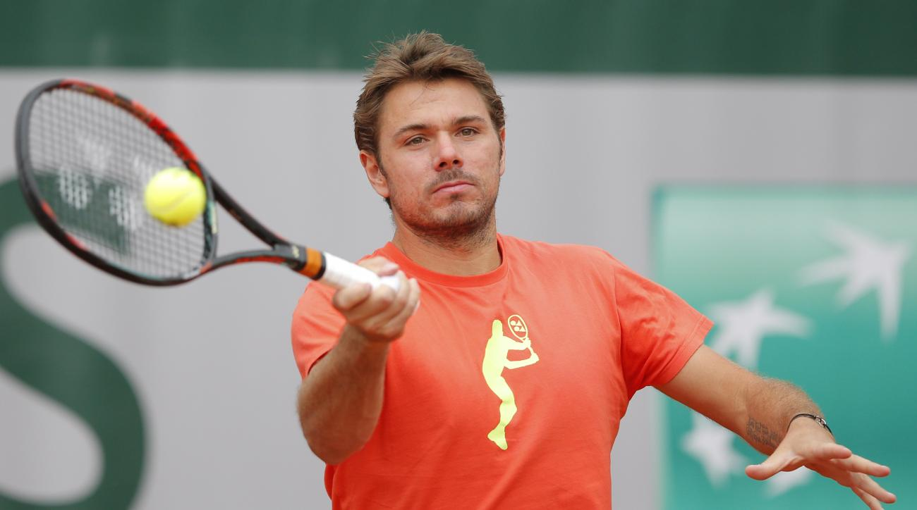 Switzerland's Stan Wawrinka returns during a training session at the French Open tennis tournament at Roland Garros stadium in Paris, France, Sunday, May 22, 2016. (AP Photo/Christophe Ena)