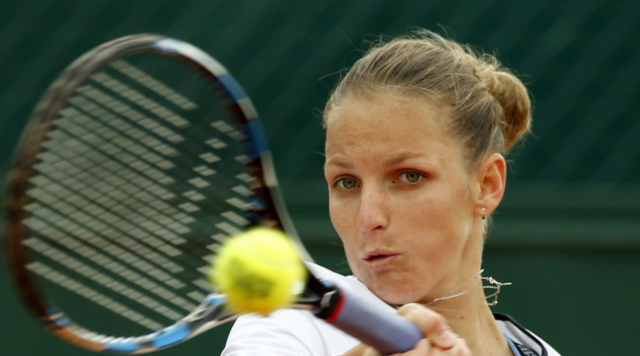 Karolina Pliskova of the Czech Republic returns the ball to Shelby Rogers of the U.S. during their first round match of the French Open tennis tournament at the Roland Garros stadium, Monday, May 23, 2016 in Paris.  (AP Photo/Alastair Grant)