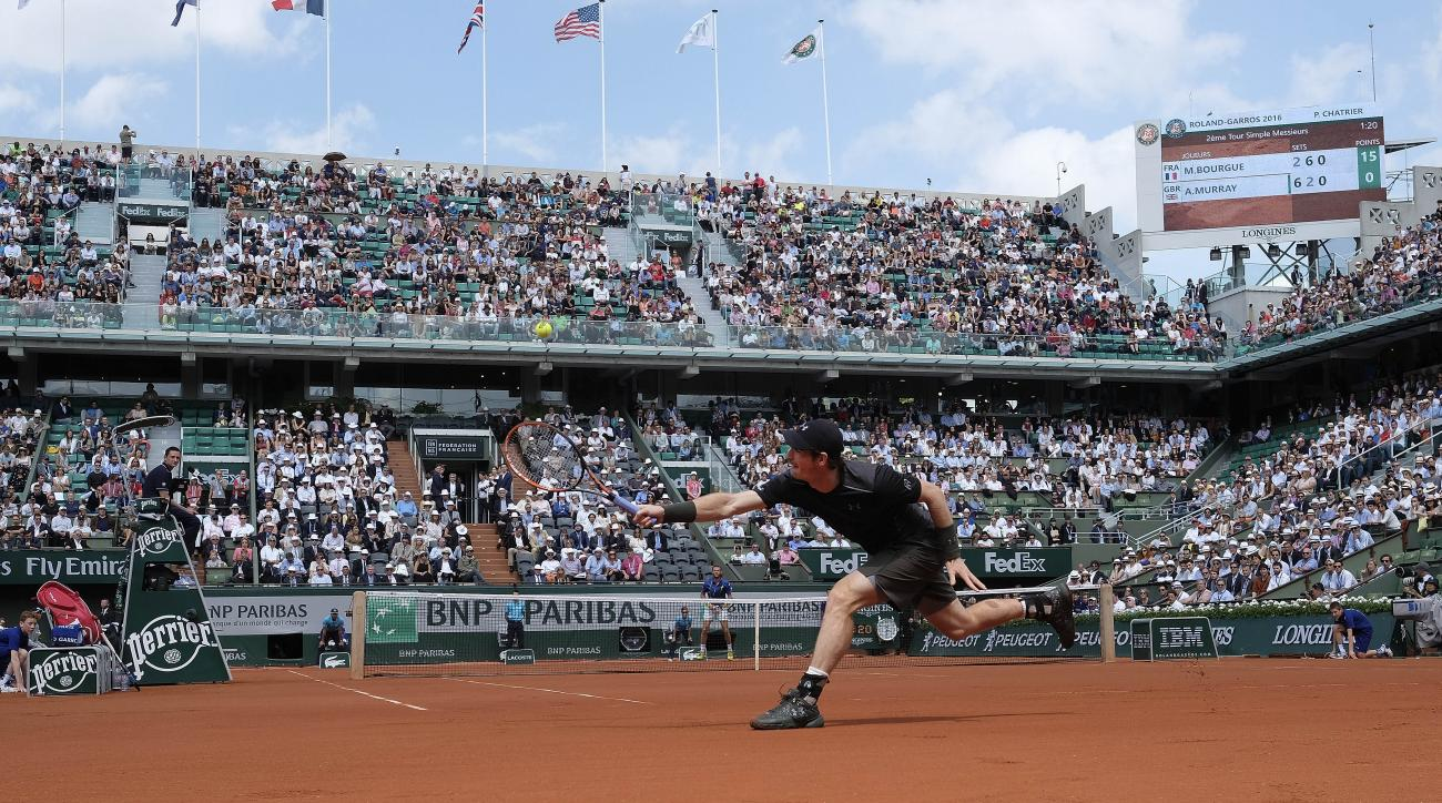 Britain's Andy Murray returns the ball to France's Mathias Bourgue during their second round match of the French Open tennis tournament at the Roland Garros stadium, Wednesday, May 25, 2016 in Paris.  (AP Photo/Alastair Grant)