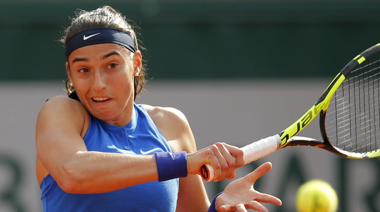 France's Caroline Garcia returns the ball to Poland's Agnieszka Radwanska during their second round match of the French Open tennis tournament at the Roland Garros stadium, Wednesday, May 25, 2016 in Paris.  (AP Photo/Christophe Ena)