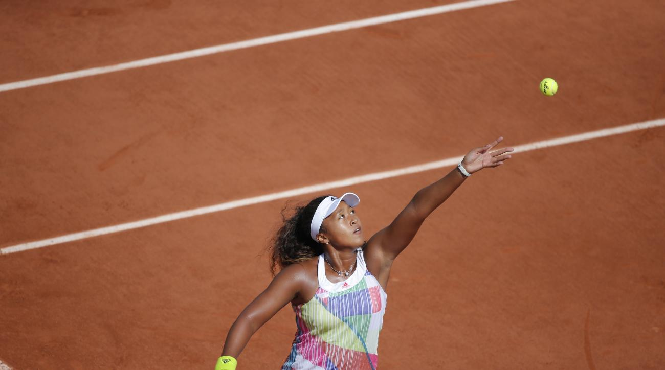 Japans Naomi Osaka returns in her third round match of the French Open tennis tournament against Romania's Simona Halep at the Roland Garros stadium in Paris, France, Friday, May 27, 2016. (AP Photo/Christophe Ena)