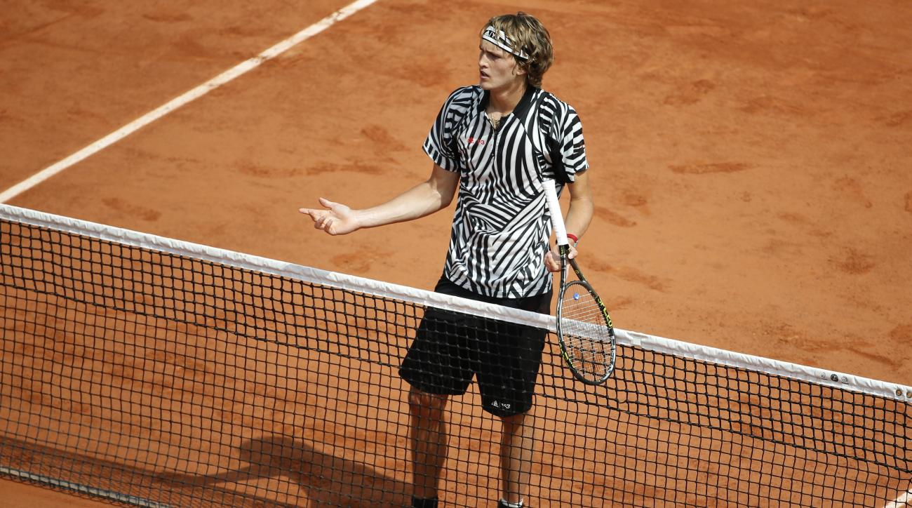 Germany's Alexander Zverev reatcs as he plays Austria's Dominic Thiem during their third round match of the French Open tennis tournament at the Roland Garros stadium, Saturday, May 28, 2016 in Paris.  (AP Photo/Alastair Grant)