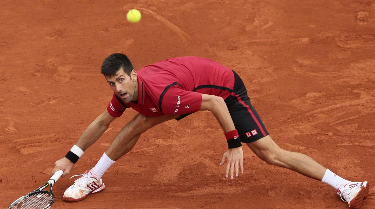 Serbia's Novak Djokovic returns the ball to Britain's Andy Murray during their final match of the French Open tennis tournament at the Roland Garros stadium, Sunday, June 5, 2016 in Paris. (AP Photo/David Vincent)
