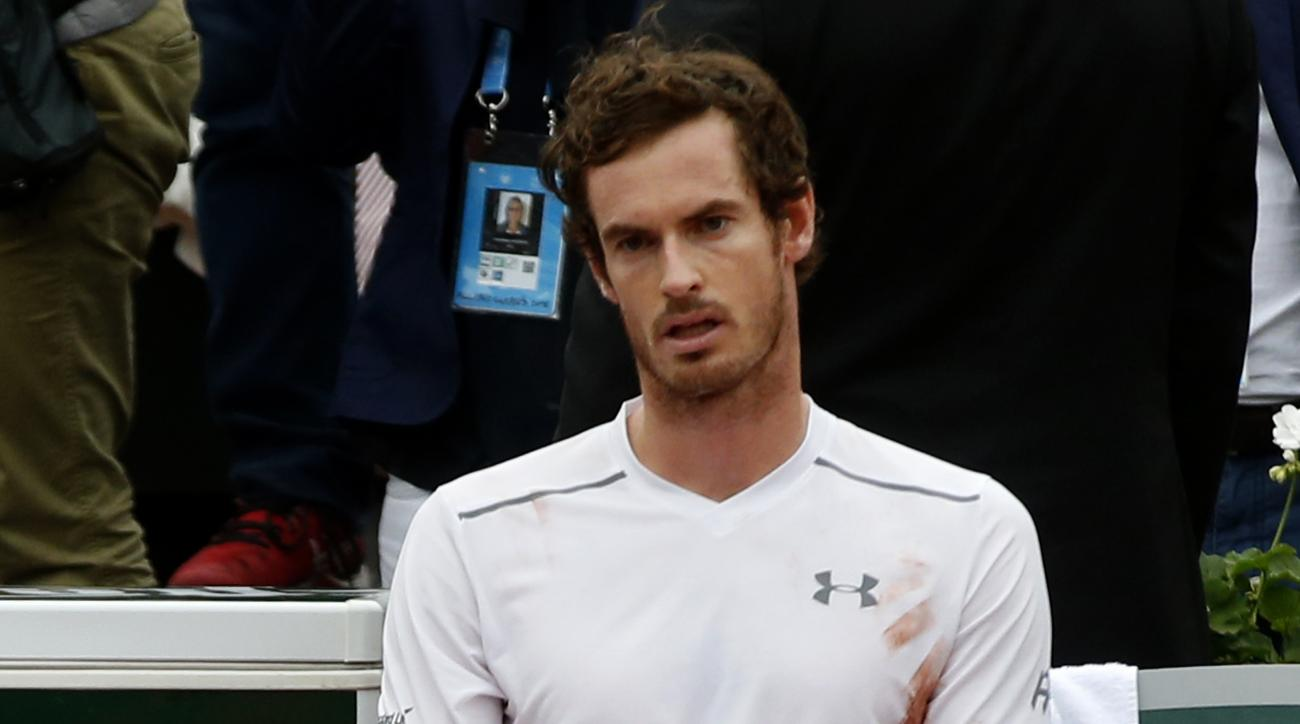 Britain's Andy Murray sits on his bench after losing to Serbia's Novak Djokovic after their final match of the French Open tennis tournament at the Roland Garros stadium, Sunday, June 5, 2016 in Paris. Djokovic won 3-6, 6-1, 6-2, 6-4.  (AP Photo/Alastair