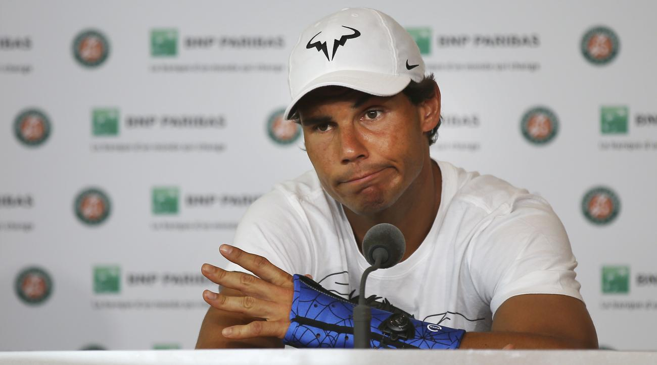 FILE - In this Friday, May 27, 2016 file photo, nine-time champion Rafael Nadal announces he is pulling out of the French Open because of an injury to his left wrist during a press conference at the Roland Garros stadium in Paris, France. Nadal has pulled
