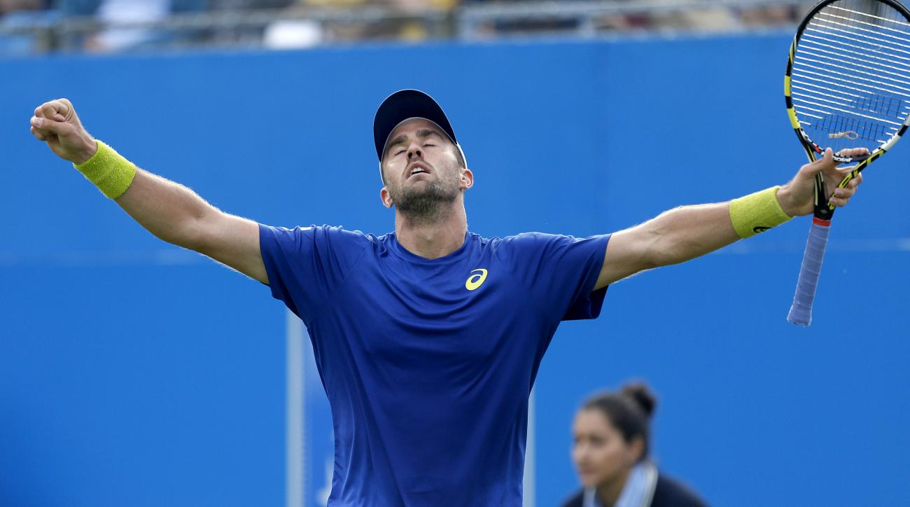 USA's Steve Johnson celebrates after winning against France's Richard Gasquet during day one of the 2016 Championships at The Queen's Club, London, Monday June 13, 2016. Johnson defeated the number four seed Gasquet, 7-6 (2), 6-2.  (Steve Paston/PA via AP