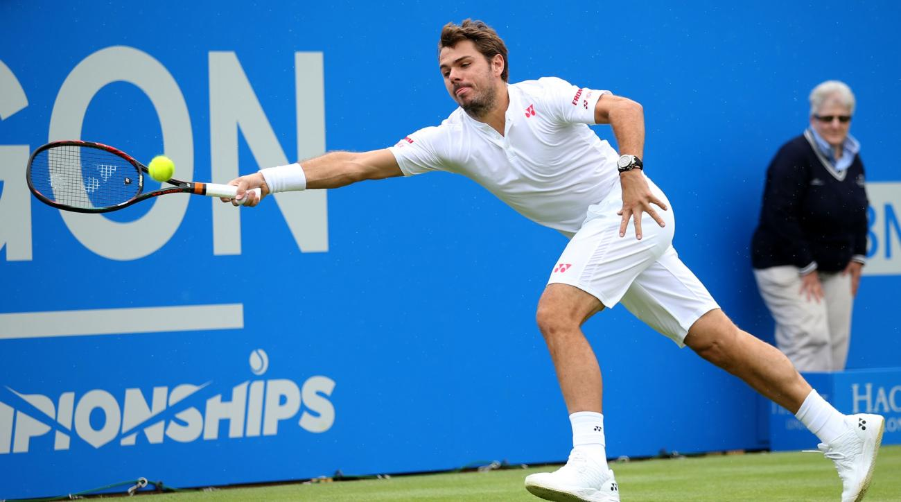 Switzerland's Stan Wawrinka returns the ball to Spain's Fernado Verdasco on day two of the Queen's grass-court tennis tournament in London, Tuesday June 14, 2016. (Steve Paston/PA via AP) UNITED KINGDOM OUT NO SALES NO ARCHIVE