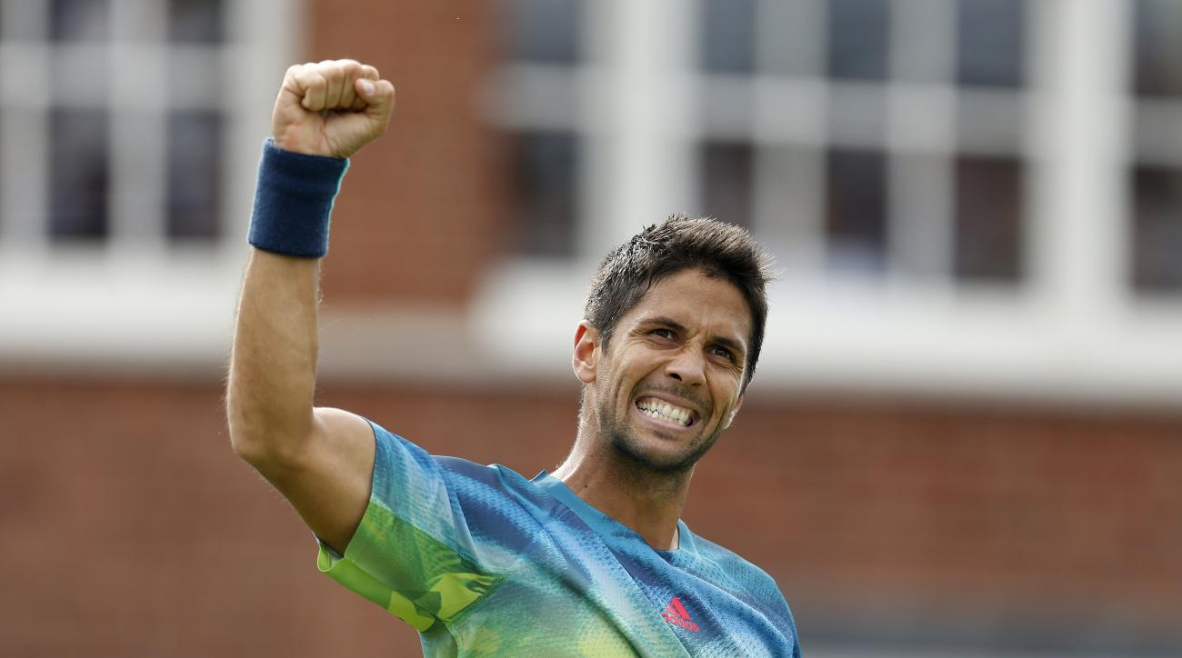 Spain's Fernado Verdasco celebrates defeating Switzerland's Stan Wawrinka 6-2, 7-6 on day two of the Queen's grass-court tennis tournament in London, Tuesday June 14, 2016. (Steve Paston/PA via AP) UNITED KINGDOM OUT NO SALES NO ARCHIVE