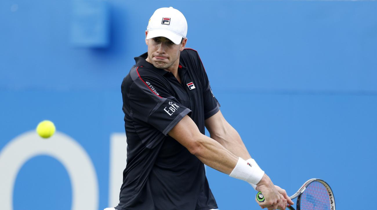 USA's John Isner plays a return in his match against Argentina's Juan Martin Del Potro during day three of the 2016 Championships at The Queen's Club, London, Wednesday June 15, 2016. Isner defeated Del Potro 7-6 (2), 6-4. (Steve Paston/PA via AP)  UNITED