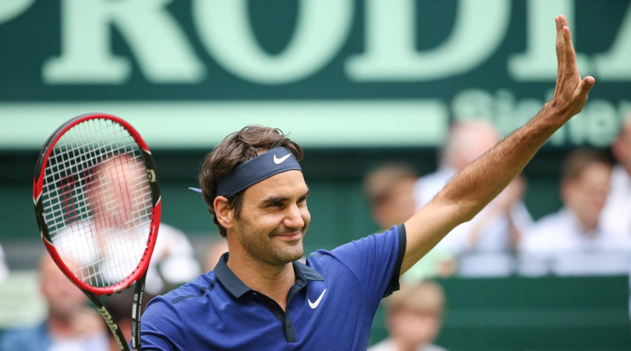 Roger Federer of Switzerland celebrates after winning against Malek Jaziri of Tunisia during the Gerry Weber Opentennis tournament in Halle,Germany, Thursday, June 16, 2016. (Friso Gentsch/dpa via AP)