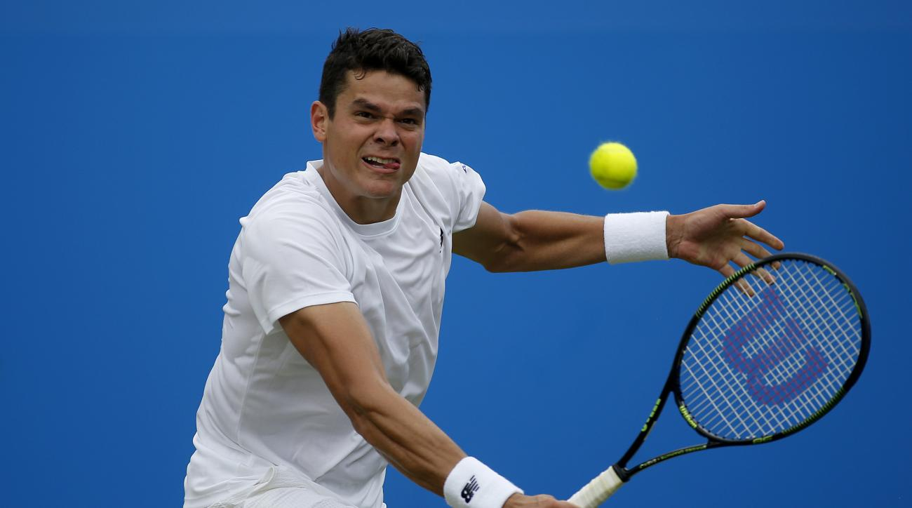 Canada's Milos Raonic makes a return to the Czech Republic's Jiri Vesely, during day four of the 2016 tennis Championships at The Queen's Club, London, Thursday June 16, 2016. (Steve Paston/PA via AP)  UNITED KINGDOM OUT  NO SALES NO ARCHIVE