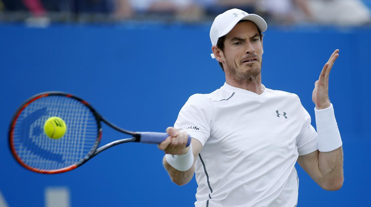 Great Britain's Andy Murray plays a return to Britain's Kyle Edmund in the quarterfinal match of the 2016 tennis Championships at The Queen's Club, London, Friday June 17, 2016. (Steve Paston/PA via AP)  UNITED KINGDOM OUT  NO SALES NO ARCHIVE