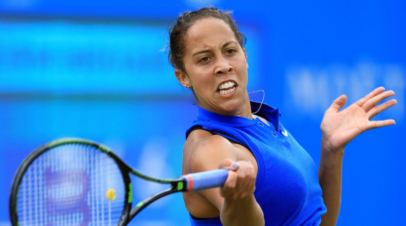 Madison Keys of the US returns a shot to Spain's Carla Suarez Navarro on day six of the Birmingham Classic women's tennis tournament at the Edgbaston Priory, Birmingham, central England, Saturday June 18, 2016. (Nigel French/PA via AP) UNITED KINGDOM OUT