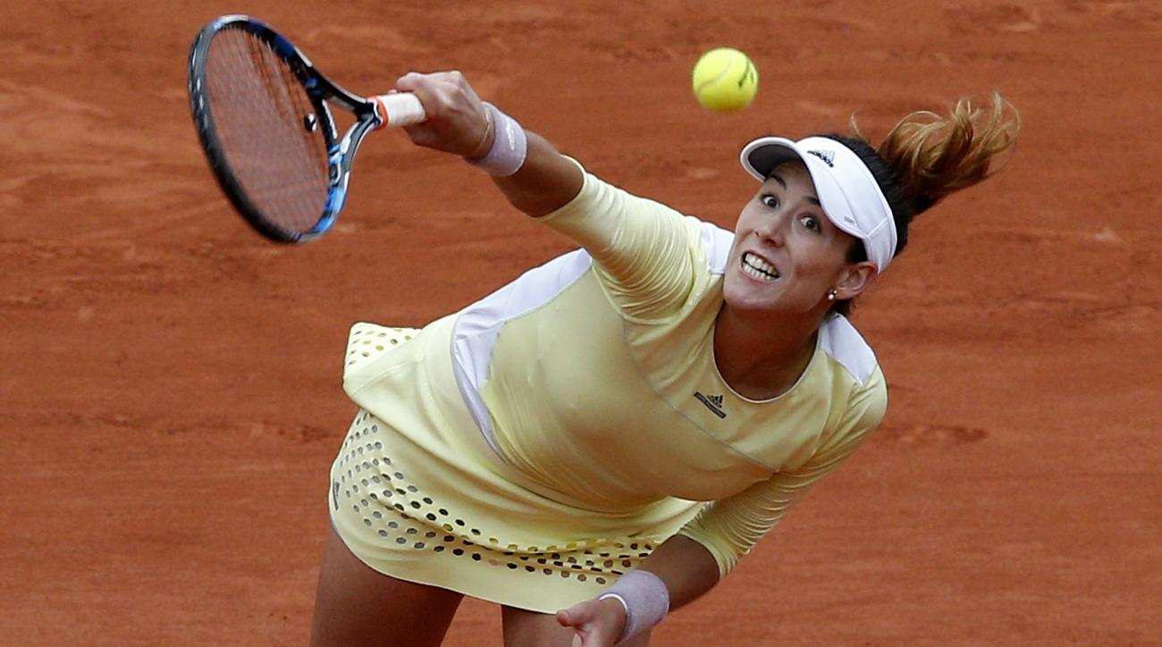 FILE - In this June 4, 2016 file photo, Spain's Garbine Muguruza serves to Serena Williams of the U.S. during their final match of the French Open tennis tournament at the Roland Garros stadium in Paris. (AP Photo/Christophe Ena)