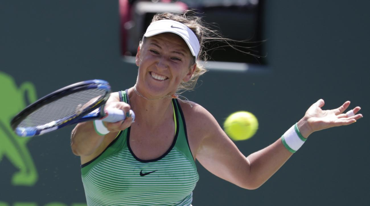 FILE - This is a Saturday, April 2, 2016 file photo of Victoria Azarenka, of Belarus, as she returns to Svetlana Kuznetsova during the women's singles final match at the Miami Open tennis tournament, in Key Biscayne, Fla. Azarenka won 6-3, 6-2. Two-time A