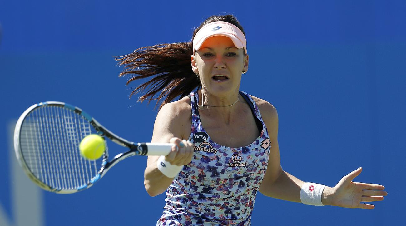 Poland's Agnieszka Radwanska returns  to Slovakia's Dominika Cibulkova during their match in the Eastbourne International women's tennis tournament at Devonshire Park, Eastbourne England Friday June 24, 2016.(Steve Paston/PA via AP)