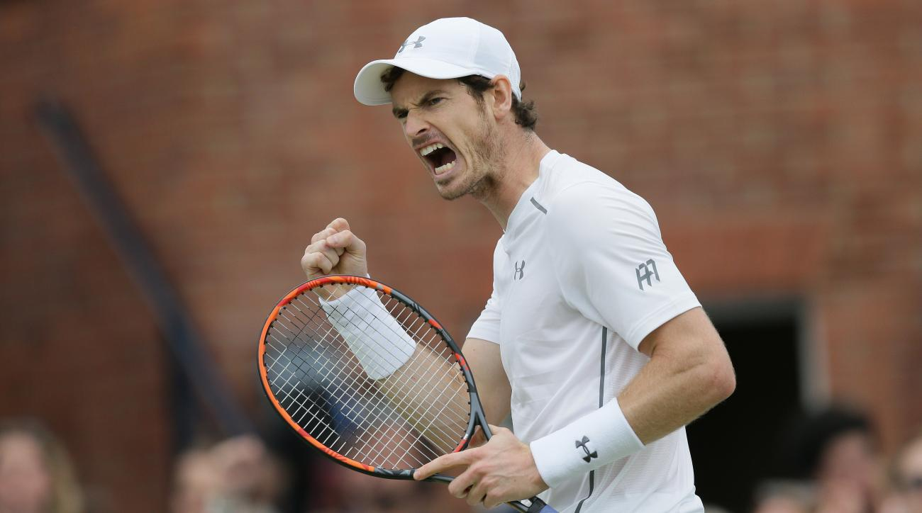 FILE - In this June 19, 2016 file photo, Britain's Andy Murray shouts after winning a point against Canada's Milos Raconic during their final tennis match on the seventh day of the Queen's Championships London, England. (AP Photo/Tim Ireland, file)