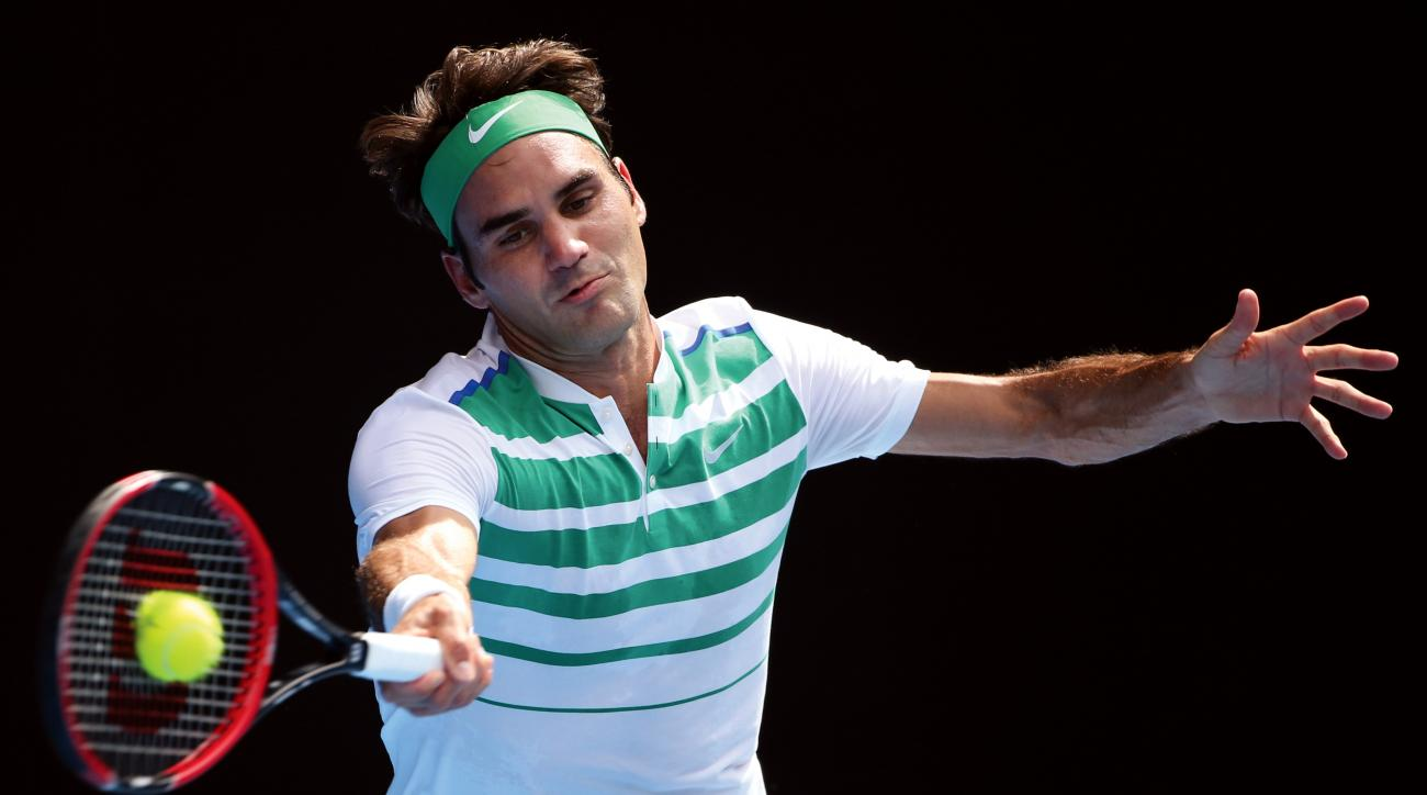 FILE - In this Jan. 26, 2016 file photo, Roger Federer of Switzerland plays a forehand return to Tomas Berdych of the Czech Republic during their quarterfinal match at the Australian Open tennis championships in Melbourne, Australia. (AP Photo/Rick Rycrof