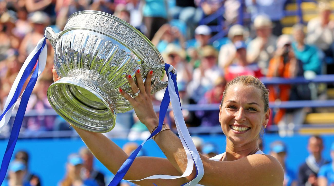 Slovakia's Dominika Cibulkova lifts the trophy after victory over Czech Republic's Karolina Pliskova during day six of the Eastbourne International women's tennis tournament at Devonshire Park, Eastbourne England, Saturday, June 25, 2016. (Gareth Fuller/P