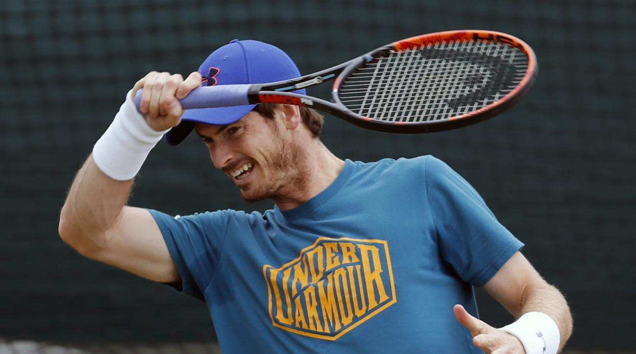 Andy Murray of Britain plays a shot ahead of the Wimbledon Tennis Championships in London,  Sunday, June 26, 2016. (AP Photo/Ben Curtis)