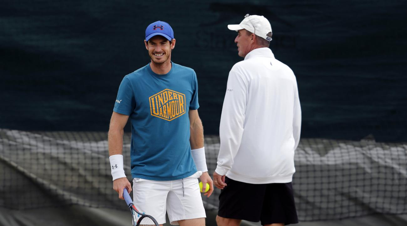 Andy Murray of Britain speaks with coach Ivan Lendl ahead of the Wimbledon Tennis Championships in London,  Sunday, June 26, 2016. (AP Photo/Ben Curtis)
