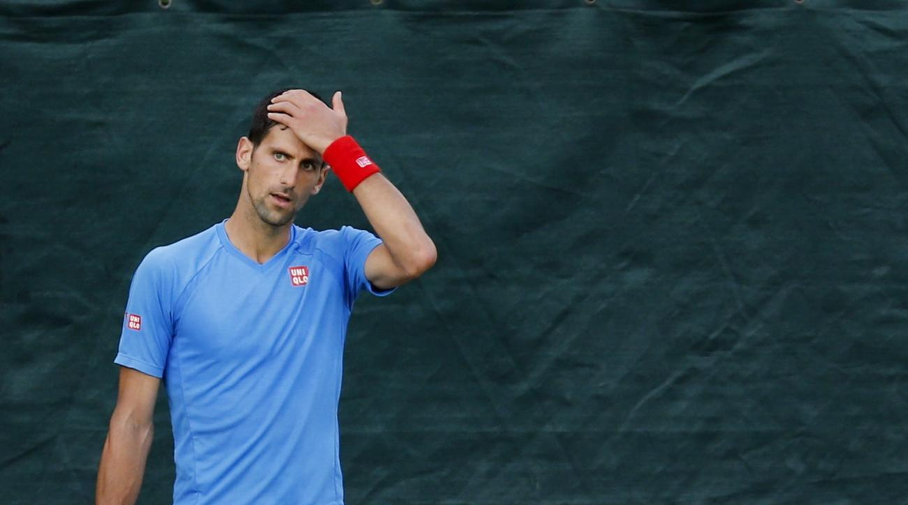 Novak Djokovic of Serbia pauses during a training session the day before the Wimbledon Tennis Championships in London,  Sunday, June 26, 2016. (AP Photo/Ben Curtis)
