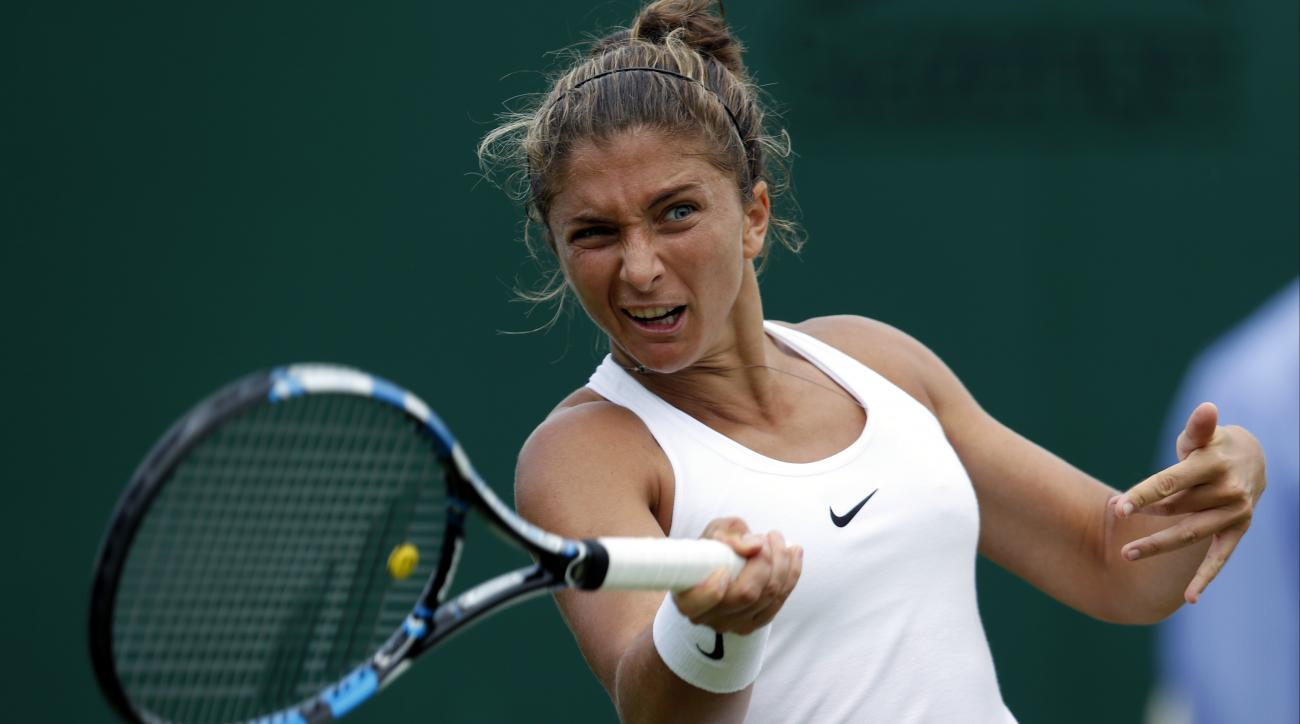 Sara Errani of Italy plays a return to Patricia Tig of Romania during their women's singles match on day one of the Wimbledon Tennis Championships in London, Monday, June 27, 2016. (AP Photo/Ben Curtis)
