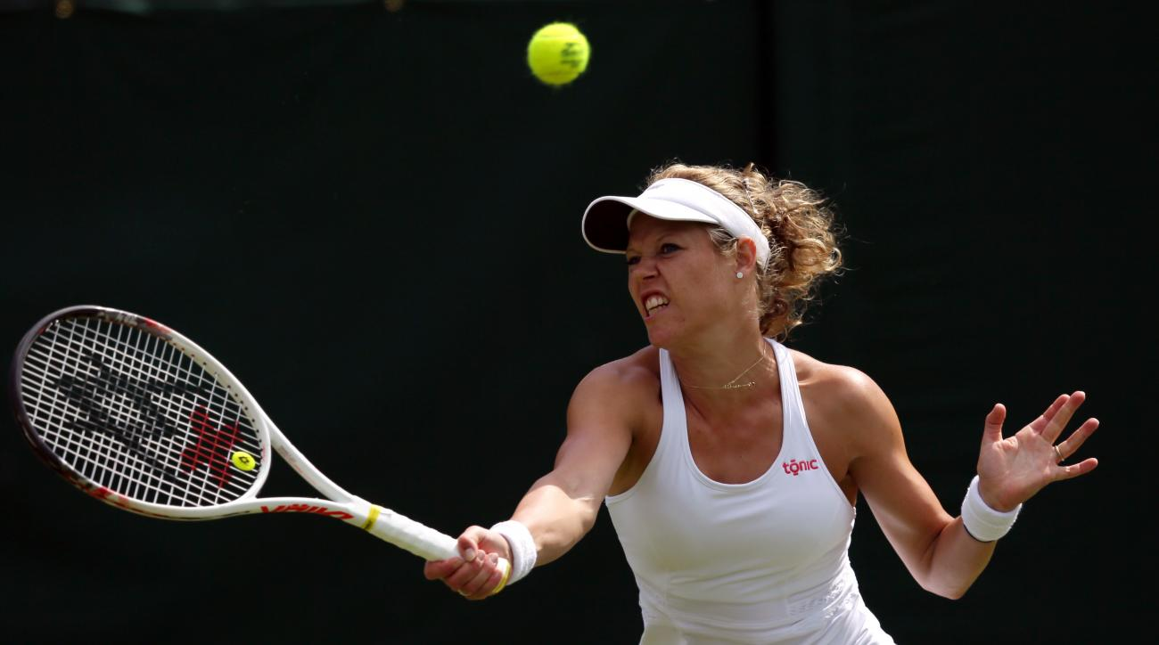 Laura Siegemund of Germany plays a return to Madison Keys of the US during their women's singles match on day one of the Wimbledon Tennis Championships in London, Monday, June 27, 2016. (AP Photo/Tim Ireland)