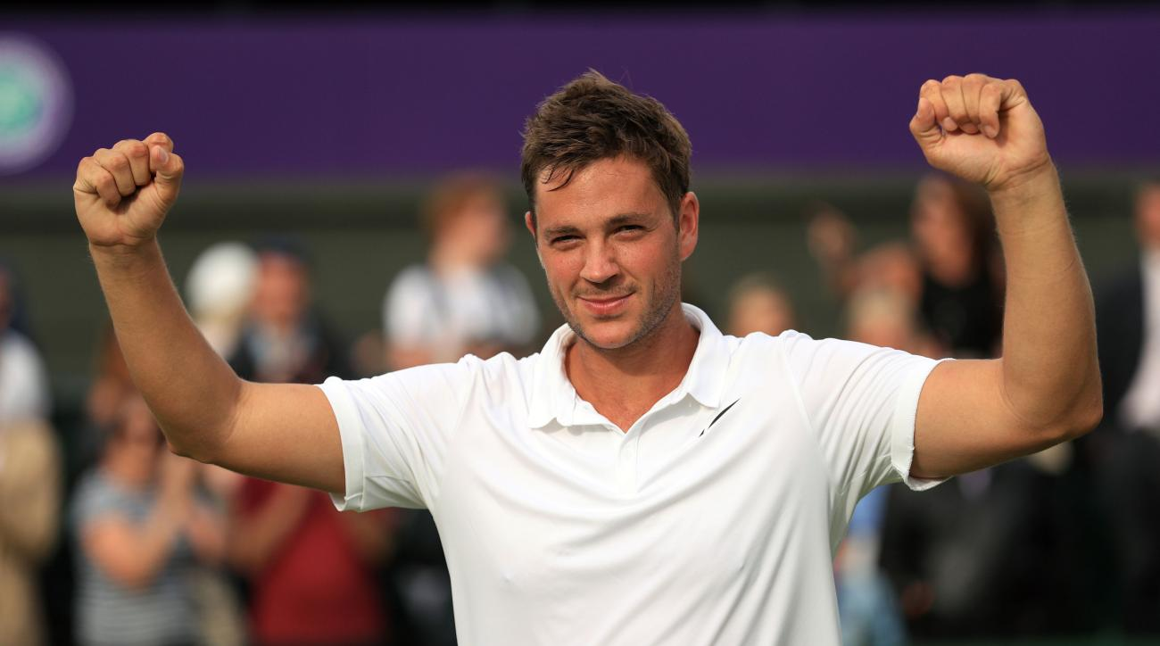 Britain's Marcus Willis, the world number 772, celebrates his victory over 54th-ranked Lithuania's Ricardas Berankis 6-3 6-3 6-4 on day one of the Wimbledon Tennis Championships in London, Monday, June 27, 2016. (Adam Davy/PA via AP) UNITED KINGDOM OUT  N