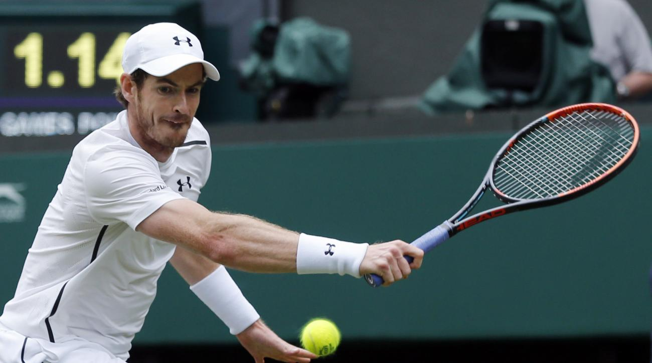 Andy Murray of Britain returns to Liam Broady of Britain during their men's singles match on day two of the Wimbledon Tennis Championships in London, Tuesday, June 28, 2016. (AP Photo/Ben Curtis)