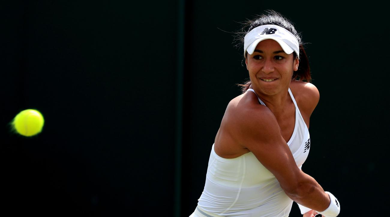 Britain's Heather Watson plays a return to Germany's  Annika Beck during their women's singles match at the  Wimbledon Championships in London Thursday June 30, 2016. (Adam Davy/PA via AP)