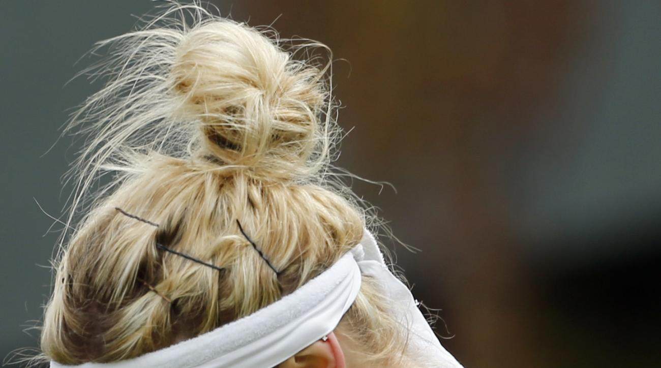 Timea Bacsinszky of Switzerland celebrates after beating Monica Niculescu of Romania in their women's singles match on day six of the Wimbledon Tennis Championships in London, Saturday, July 2, 2016. (AP Photo/Alastair Grant)