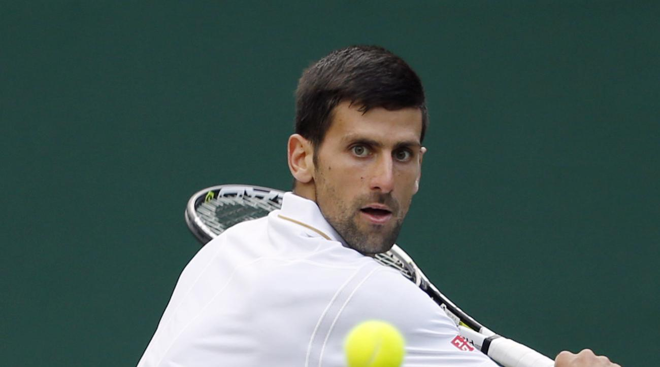 Novak Djokovic of Serbia returns to Sam Querrey of the U.S during their men's singles match on day six of the Wimbledon Tennis Championships in London, Saturday, July 2, 2016. (AP Photo/Alastair Grant)