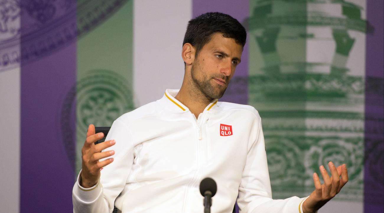 Novak Djokovic of Serbia gestures during a press conference, after being defeated by Sam Querrey of the U.S in their men's singles match on day six of the Wimbledon Tennis Championships in London, Saturday, July 2, 2016. (Joe Toth/Pool Photo via AP)