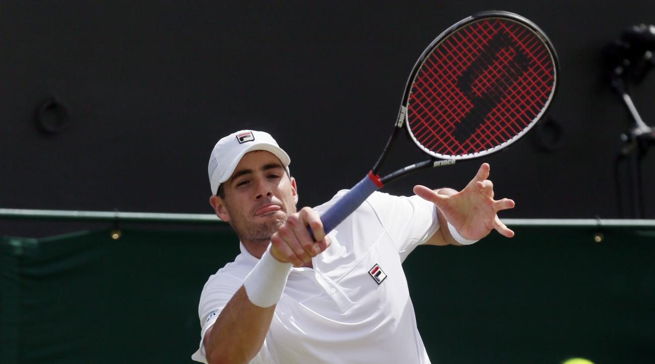 John Isner of the U.S returns to Jo-Wilfried Tsonga of France during their men's singles match on day seven of the Wimbledon Tennis Championships in London, Sunday, July 3, 2016. (AP Photo/Tim Ireland)