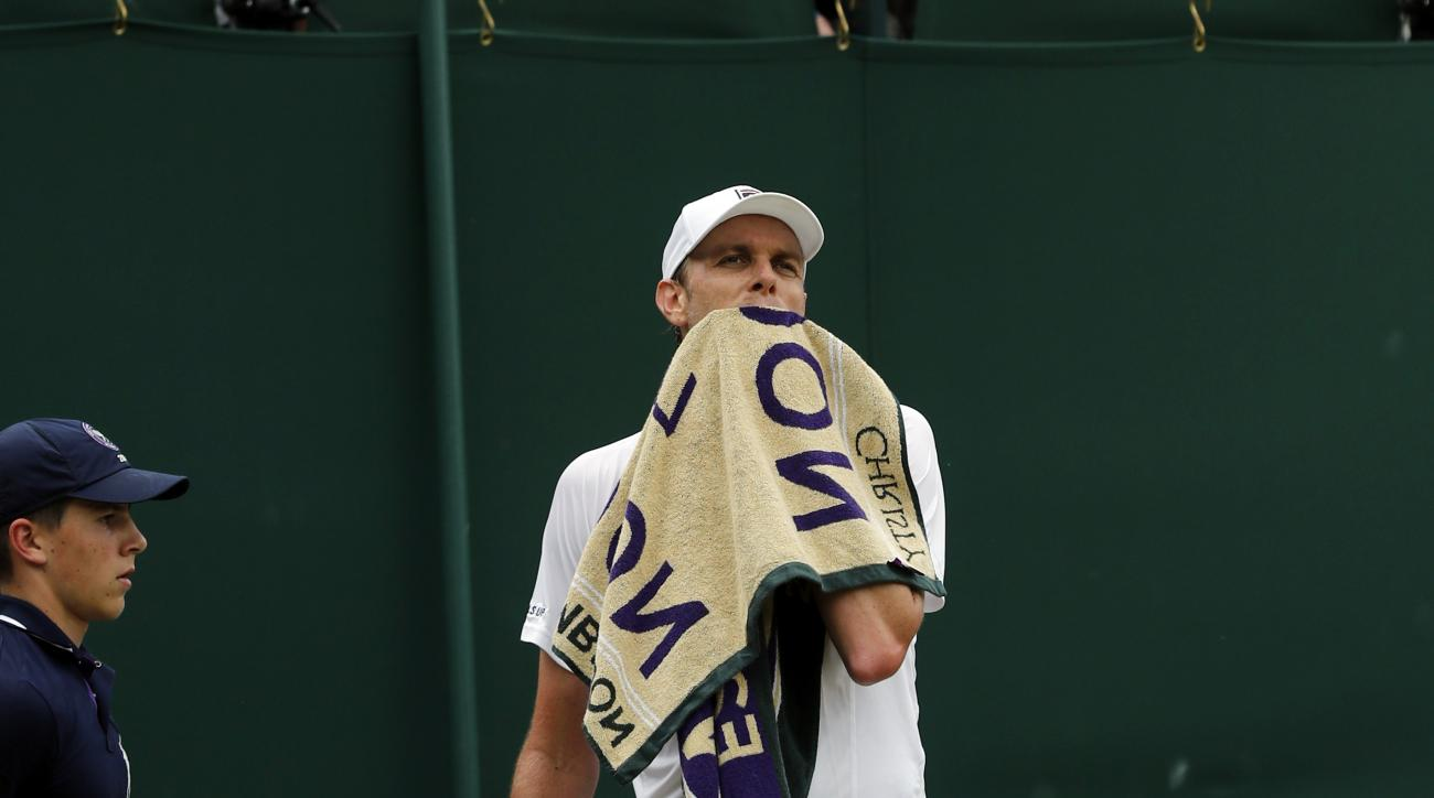 Sam Querrey of the U.S wipes his face during his men's singles match against Nicolas Mahut of France on day eight of the Wimbledon Tennis Championships in London, Monday, July 4, 2016. (AP Photo/Ben Curtis)