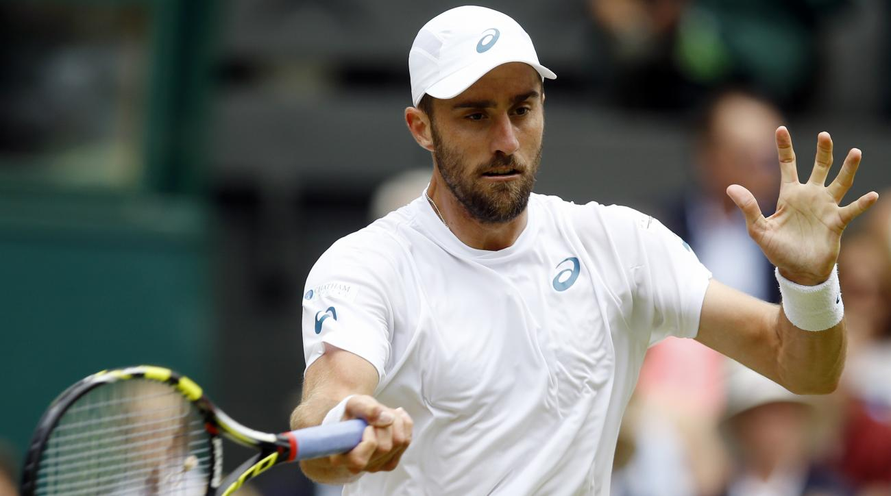 Steve Johnson of the U.S returns to Roger Federer of Switzerland during their men's singles match on day eight of the Wimbledon Tennis Championships in London, Monday, July 4, 2016. (AP Photo/Kirsty Wigglesworth)