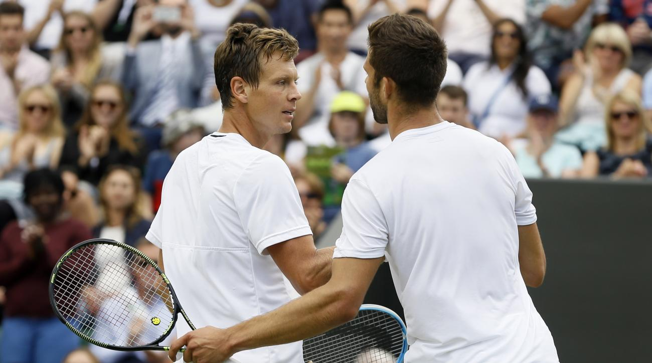Tomas Berdych of the Czech Republic, left, shakes hands with Jiri Vesely of the Czech Republic after beating him in their men's singles match on day nine of the Wimbledon Tennis Championships in London, Tuesday, July 5, 2016. (AP Photo/Kirsty Wigglesworth